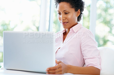Buy stock photo Attractive woman working on laptop