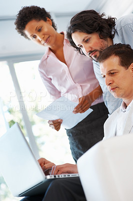 Buy stock photo Business people looking at laptop in the office