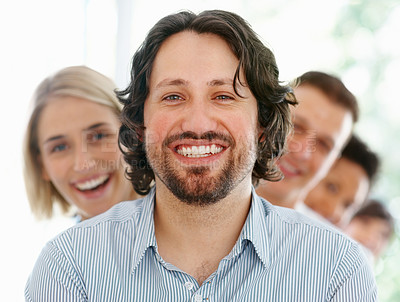 Buy stock photo Closeup of smart young business man with supporting team in background