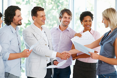 Buy stock photo Leader shaking hands with female executive in the office