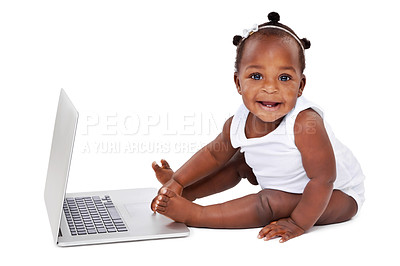 Buy stock photo Studio shot of an adorable baby girl using a laptop isolated on white