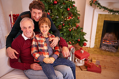 Buy stock photo Shot of a young boy with his dad and granddad on Christmas