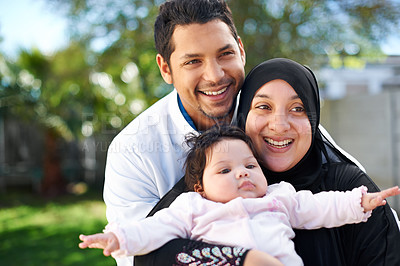Buy stock photo Portrait of a muslim family enjoying a day outside