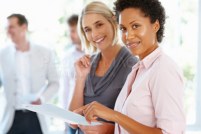 Buy stock photo Two business women discussing project and smiling at office