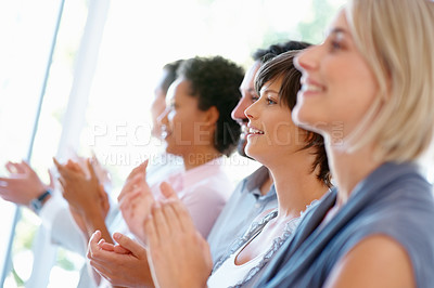 Buy stock photo Smiling business people standing in row and clapping