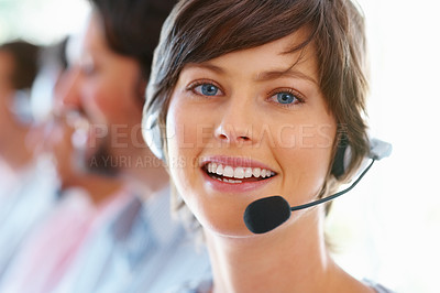 Buy stock photo Closeup of beautiful customer service woman with team in background