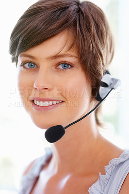 Buy stock photo Closeup of smiling young executive in headphones