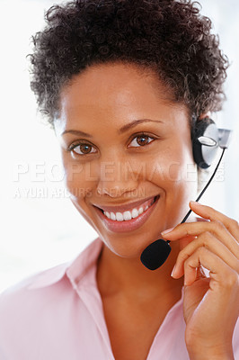 Buy stock photo Beautiful female executive wearing headset and smiling