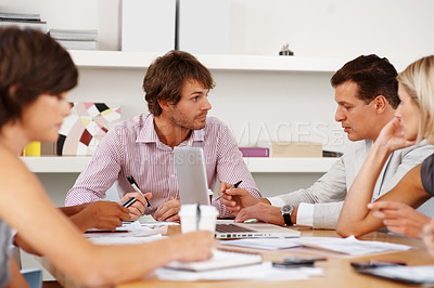 Buy stock photo Two business men signing documents with their team in the office