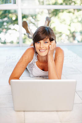 Buy stock photo Smiling beautiful woman lying on floor with laptop