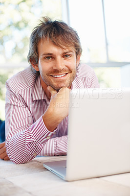 Buy stock photo Portrait of young business man relaxing on floor with laptop