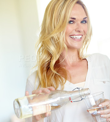 Pouring herself a glass of water