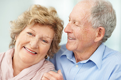 Buy stock photo Portrait of a senior woman sitting down while her husband looks at her