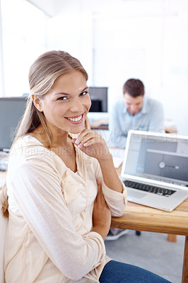 Buy stock photo Portrait of two positive-looking young designers at work on their computers