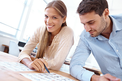 Buy stock photo Portrait of two young designers looking over images together