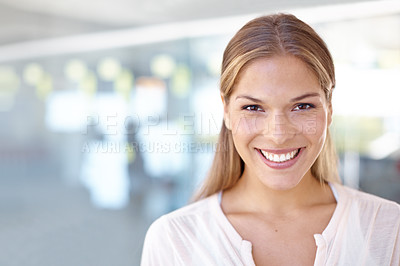 Buy stock photo Portrait of a young female business professional standing in an office
