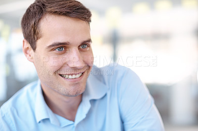 Buy stock photo Closeup portrait of a handsome young business professional sitting in an office