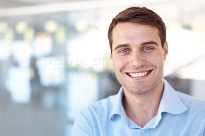 Buy stock photo Portrait of a smiling young business professional standing in an office