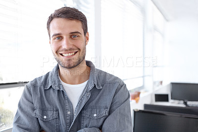Buy stock photo Handsome young casual businessman smiling at the camera with his arms folded - copyspace
