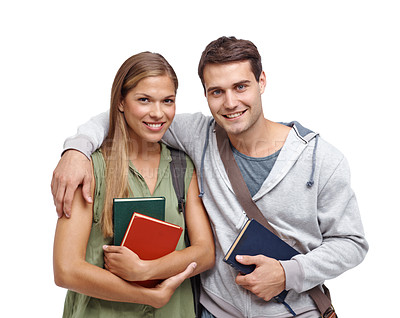 Buy stock photo Young student couple smiling while holding their textbooks