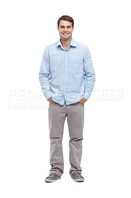 Buy stock photo Handsome young man smiling at the camera with his hands in his pockets