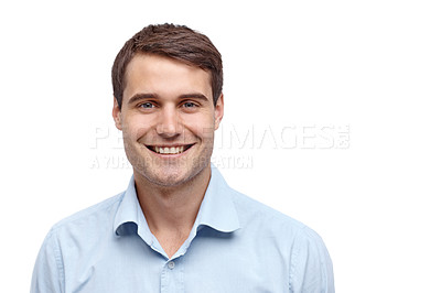 Buy stock photo Handsome young man smiling at the camera - copyspace
