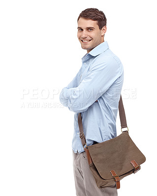 Buy stock photo Handsome young man wearing a satchel and smiling at the camera with his arms folded - profile