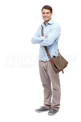 Buy stock photo Handsome young man wearing a satchel and smiling at the camera with his arms folded - copyspace