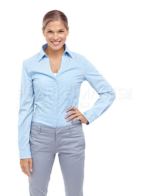 Buy stock photo Happy young woman standing with her hand on her hip