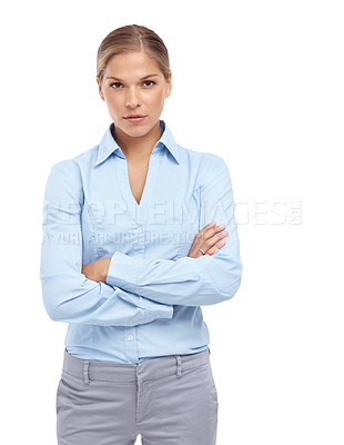 Buy stock photo Serious young woman looking at the camera with her arms folded