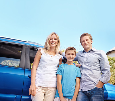 Buy stock photo A family of three standing in their driveway at home