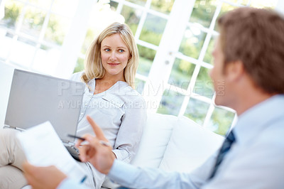 Buy stock photo A pretty woman listening to her husband while working on a financial budget