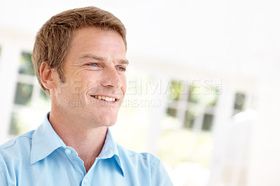 Buy stock photo Closeup shot of a handsome man looking into the distance