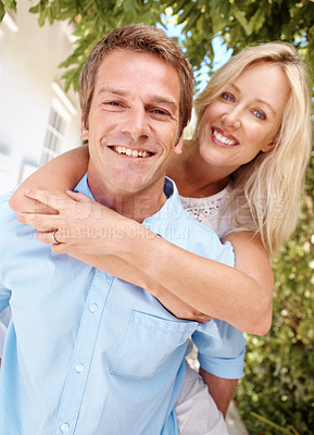 Buy stock photo Beautiful mature woman hugging her husband from behind