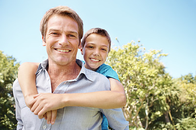 Buy stock photo Handsome father piggybacking his young son
