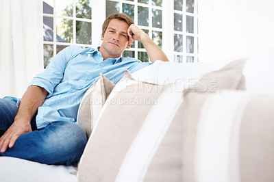 Buy stock photo Handsome mature man sitting on the sofa at home