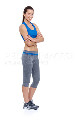 Buy stock photo Full length of a fit young woman crossing her arms while isolated on a white background