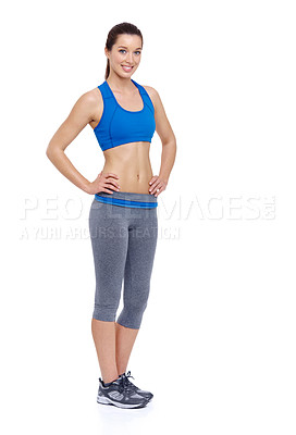 Buy stock photo Full length of a fit young woman with her hands on her hips while isolated on a white background