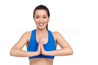 Buy stock photo A pretty young woman with her hands together performing a yoga routine