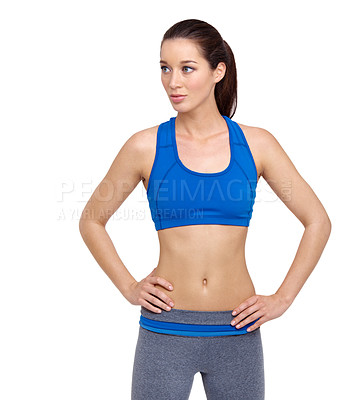 Buy stock photo A fit young woman with her hands on her hips looking away while isolated on white