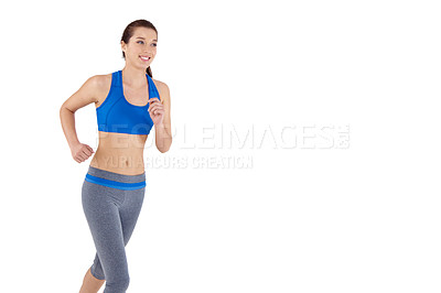 Buy stock photo A pretty young woman running while isolated on a white background - Copyspace
