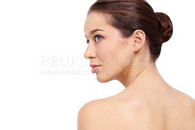 Buy stock photo Rear-view of a beautiful young woman looking away while isolated on a white background