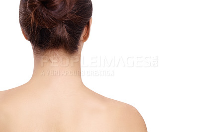 Buy stock photo Rear-view of a young woman with her hair tied up isolated on a white background