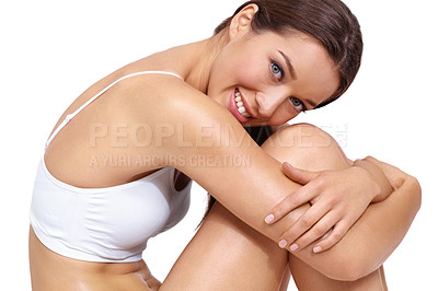 Buy stock photo A stunning young woman hugging her legs while isolated on a white background - copyspace