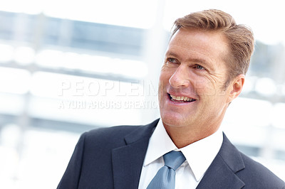Buy stock photo A confident businessman smiling and looking away thoughtfully