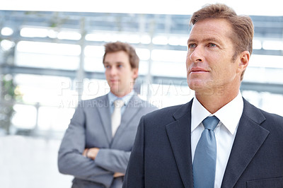 Buy stock photo An ambitious businessman looking away thoughtfully