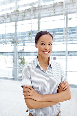 Buy stock photo A pretty young businesswoman crossing her arms and smiling