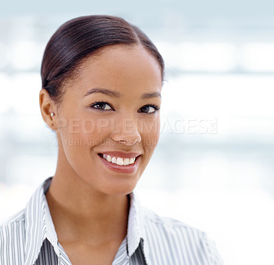 Buy stock photo Portrait of a pretty african american businesswoman smiling alongside copyspace