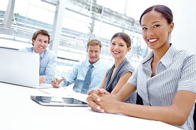 Buy stock photo A team of businesspeople sitting around the boardroom table