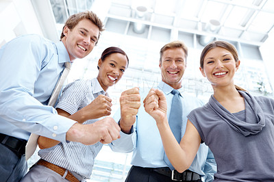 Buy stock photo A group of happy businesspeople making fists in a gesture of victory